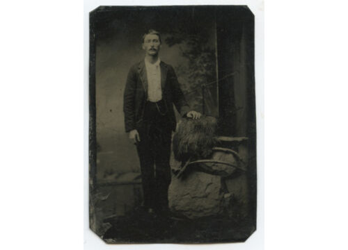 PORTRAIT OF YOUNG WELL DRESSED MAN W/ PAINTED BACKDROP TINTYPE