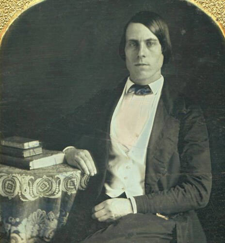 EARLY 1/6 PLATE DAGUERREOTYPE PORTRAIT OF A YOUNG MAN WITH BOOKS