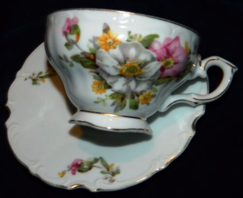 VINTAGE Japan Royal Sealy Footed Teacup And Notched Saucer with Flowers