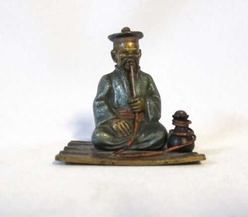 Antique Vienna bronze cold painted man smoking on a rug (#963)