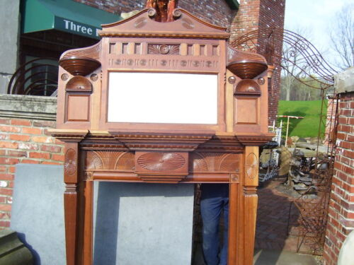 Refinished carved cherry fireplace mantel