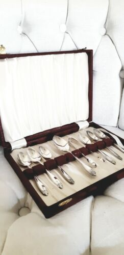 EPNS A1 Sheffield plated boxed teaspoons with serving spoon and sugar tongs.