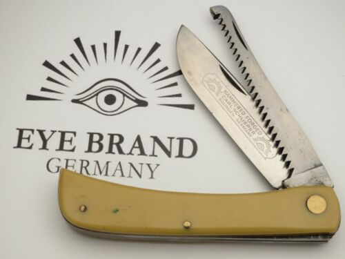 Vintage EYE BRAND Solingen Two-Blade Sodbuster with Saw Yellow Handles