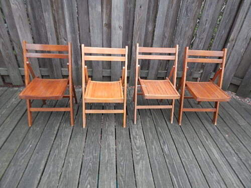 SET OF FOUR WOODEN FOLD UP CHAIRS MADE IN ROMANIA LOCAL PICK UP ONLY