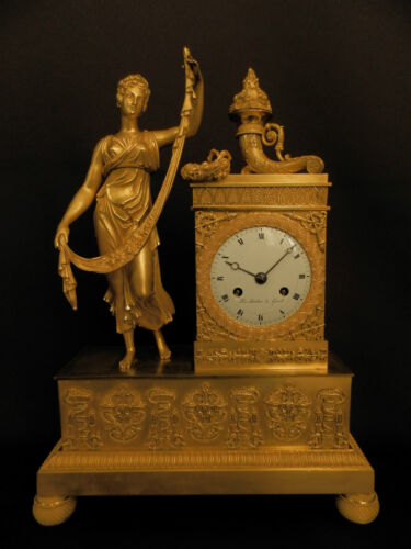 Antique French Early gilt bronze mantel clock with Goddess of Fertility ca 1810