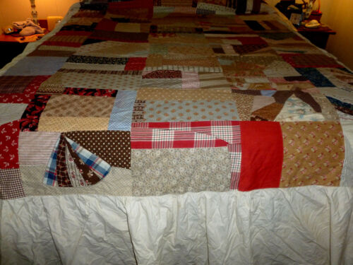 Handmade Patchwork Quilt with bed ruffle edged with quilt squares