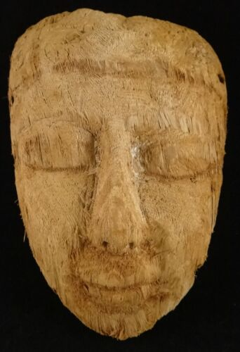 """Ancient Egyptian carved wood mummy mask, 600-30 BCE, 9 ¾"""" x 6 ¾"""" ."""