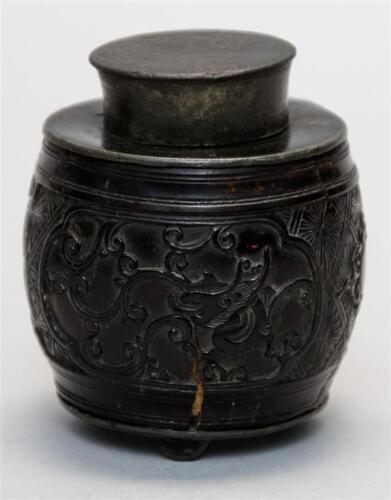 CHINESE CARVED COCONUT SHELL TEA CADDY In barrel form with pewter lini... Lot 87