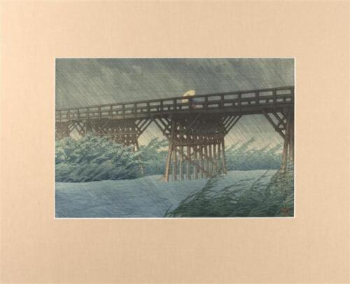 "KAWASE HASUI ""Sudden Shower at Imai"". Depicting a figure crossing a b... Lot 628"