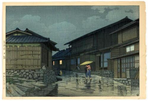 "KAWASE HASUI ""Rain in Nissaka"". Depicting a woman carrying a child on... Lot 636"