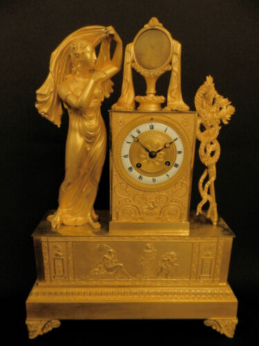 Antique French Early gilt bronze mantel clock with Lady and mirror  ca 1830