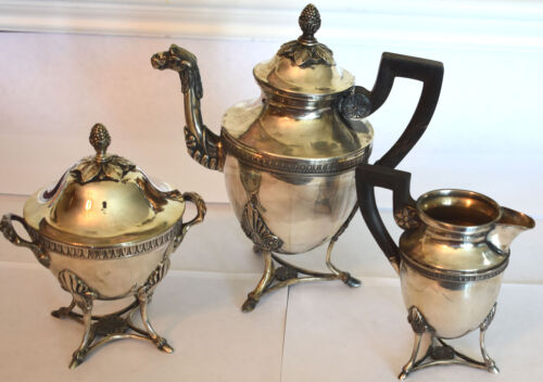 THREE PIECE CAMEL FOOTED SILVER TEA SET 800 900 MARKS