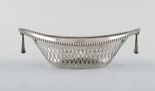 European silversmith. Silver bowl with reticulated decoration and handles.