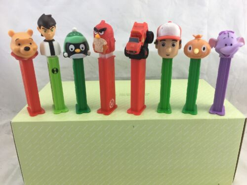 8 X PEZ DISPENSERS *HOT WHEELS *BEN 10 *ANGRY BIRD *POOH & MORE.