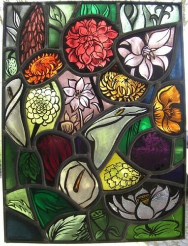 Antique stained glass window with flowers (sunflower,water lily,chrysanthemum)