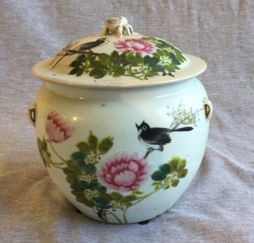 A Chinese Porcelain Jar With Lid