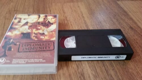 DIPLOMATIC IMMUNITY - BRUCE BOXLEITNER, BILLY DRAGO  1991 VHS VIDEO