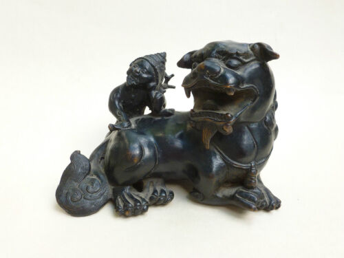 A Chinese Or Japanese Bronze Lion with Old Man