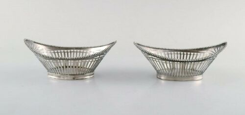 European silversmith. A pair of silver bowls with reticulated decoration.