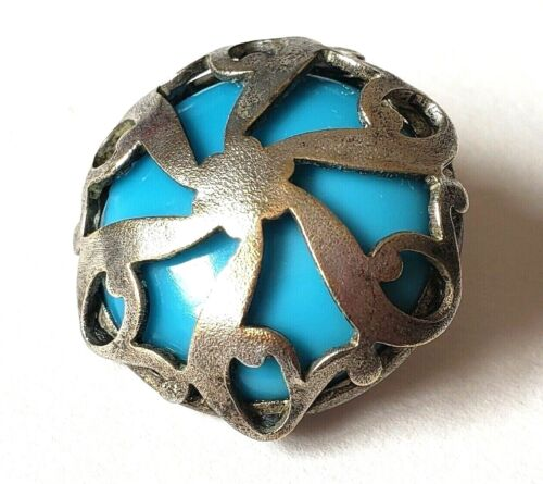 Unusual Vintage Button…Unusual Glass Background…Metal Over Turquoise Glass