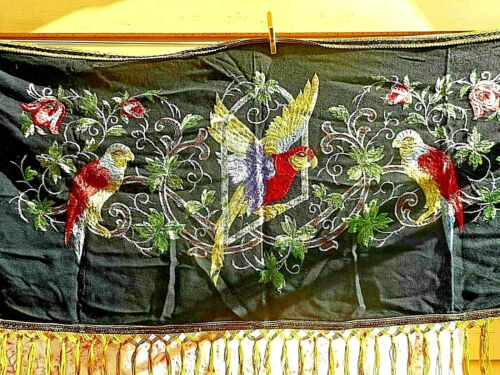 Antique hand embroidered wall hanging on black wool
