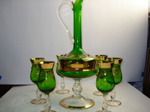BOHEMIAN GREEN GLASS FOOTED DECANTER & SIX CORDIAL GLASSES WITH RED BEADS