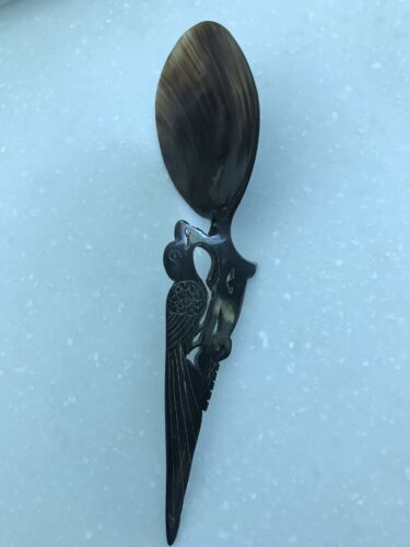 buffalo horn carved spoon, 10 1/2 inches by 3 1/4 inches bird motif.