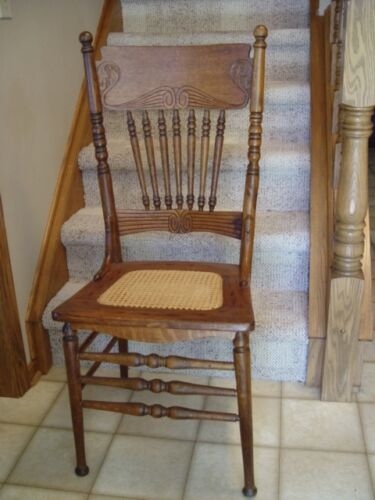 Victorian antique oak pressed back chair cane seat spindles