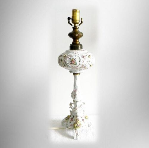 Tall lamp with ornate flower heads and gold designs