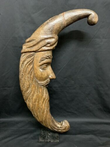 CARVED WOOD MAN IN CRESCENT MOON PAPERMACHE MOLD/SCULPTURE