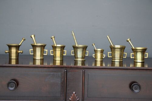 Antique collection of 7 heavy 18th century mortar and pestles of various sizes