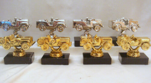 LOT OF 8 VINTAGE METAL JEEP 4 SILVER AND 4 GOLD.  MARBLE NOT INCLUDED.