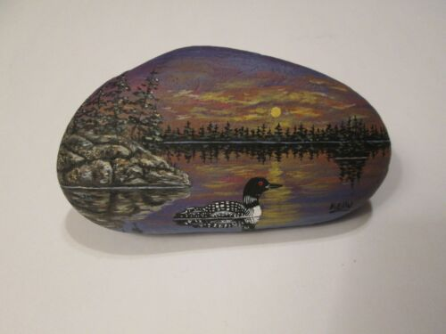Loon and Sunset hand painted on a rock by Ann Kelly