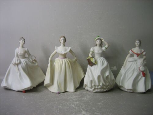 Set of 4  hand painted beautiful lady figurines. COLLECTABLE