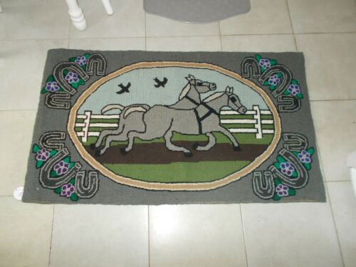 EARLY 1900S HAND HOOKED RUG WITH TWO HORSES IN HARNESS WITH TWO BIRDS HORSESHOES