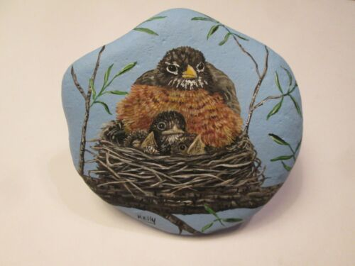 Robin and Chicks hand painted on a rock by Ann Kelly
