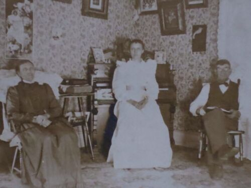 1899 ~ LIVING ROOM SETTING, ORGAN, PICTURES, ROCKERS, MOM, DAD, DAUGHTER