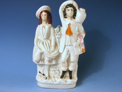 ANTIQUE STAFFORDSHIRE GROUP 'COUPLE HOLDING A WEDDING JUG'