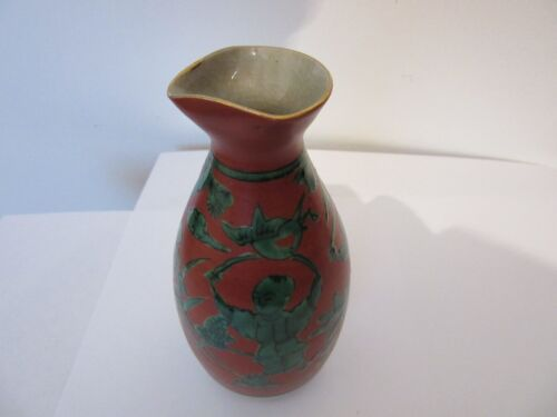 JAPANESE POTTERY SAKE BOTTLE WITH GREEN ON RED FIGHTING WORRIERS