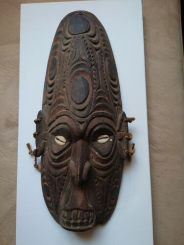 PNG mask, tribal deity, genuine, mounted.