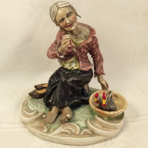 Vintage porcelain statuette of an elderly woman with chickens