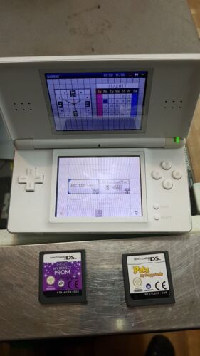 random color nintendo ds lite console with 2 games