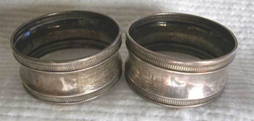 A FINE ANTIQUE -19TH CENTURY SOLID SILVER PAIR OF FRENCH NAPKIN RINGS