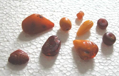 A FINE ANTIQUE GROUP OF AMBER BEADS (4) AND OTHER (5) PIECES