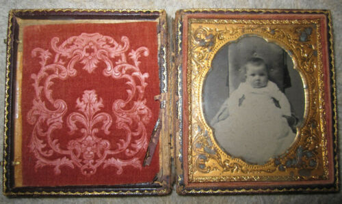 Antique folding tooled leather photo frame with tintype B&W baby picture, hooks