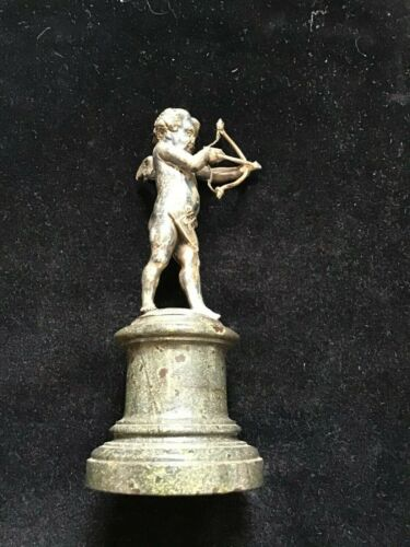 ANTIQUE SILVER PLATED SILVER CHERUB & BOW AND ARROW ON MARBLE BASE.