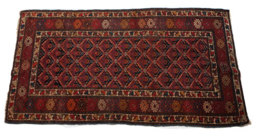 Caucasian Wool Rug, circa 1920. Red Field Floral Pattern
