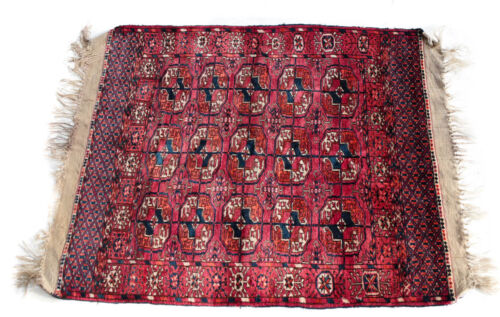 Turkemen Wool Rug, circa 1920. Pink and Red Floral Geometric Design