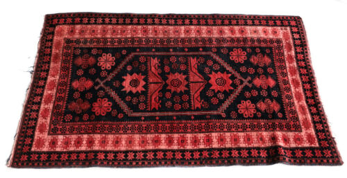 Caucasian Wool Rug, circa 1920. Pink and Dark Blue/Back Floral Geometric Designs