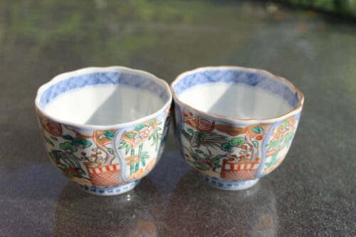 Pair of Japanese porcelain sake cups with a seal